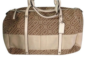 9.  Coach Lozenge Satchel Bag