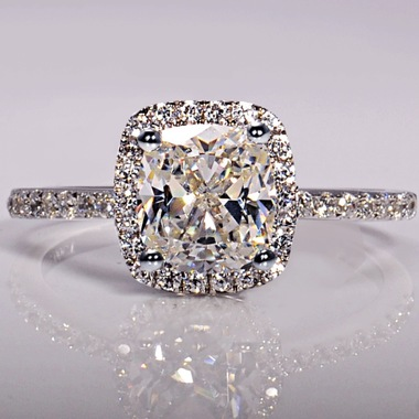 Flawless Halo Set Round Cut Zirconia Diamond with Side Stones on a White Gold Fi