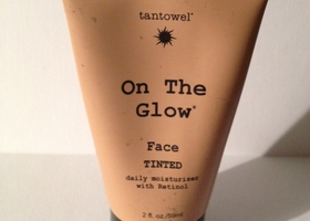 Tan Towel . On The Glow Tinted Moisturizer With Retinol
