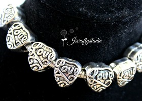 "10+ Antiqued Silver ""LOVE"" heart European Spacers"